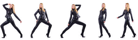 Dancing woman in black leather costume 免版税图像