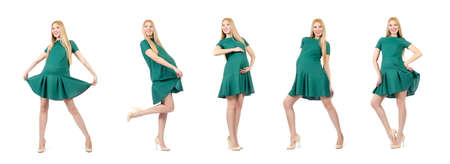 Beautiful pregnant woman in green dress isolated on white Banque d'images