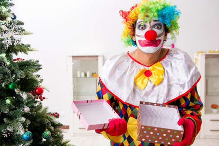 Funny clown in Christmas celebration concept Stock Photo
