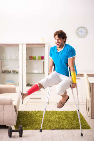 Injured man recovering from his injury Stock Photo