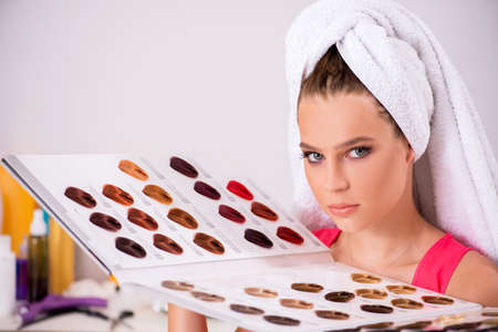 Customer choosing colour for her hair Stock Photo