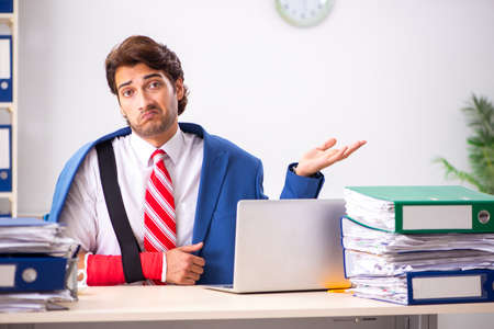 Injured employee working in the office Stock Photo