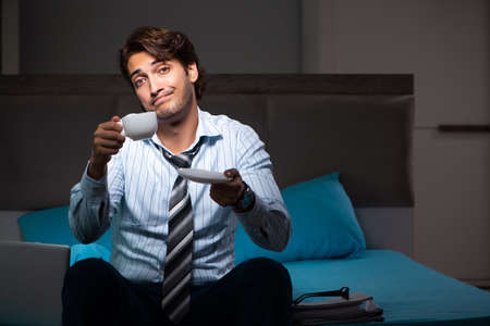 Tired businessman working overtime at home at night