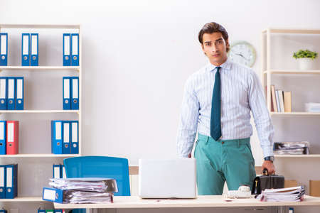 Businessman disgusted with cockroaches in the office Stock Photo