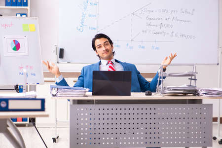 Male sales analyst in front of the whiteboard Stock fotó