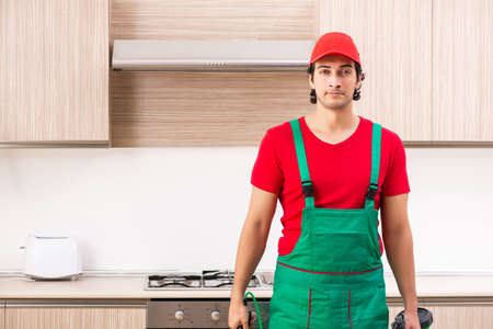 Professional contractor doing pest control at kitchen Stock Photo