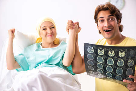 Husband looking after wife in hospital Stock Photo - 115017229