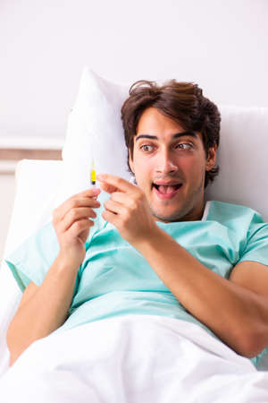 Young handsome man staying in hospital Stockfoto