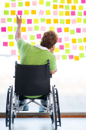 Young student in wheelchair with many conflicting priorities Banque d'images