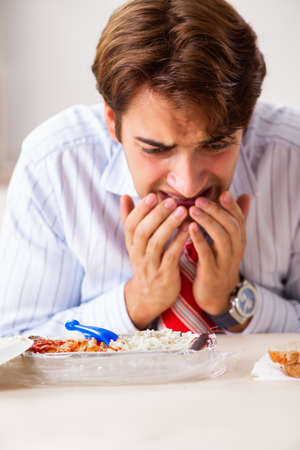Employee eating food with cockroaches crawling around