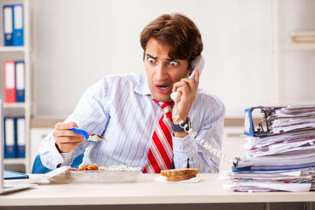 Employee eating food with cockroaches crawling around Stock Photo