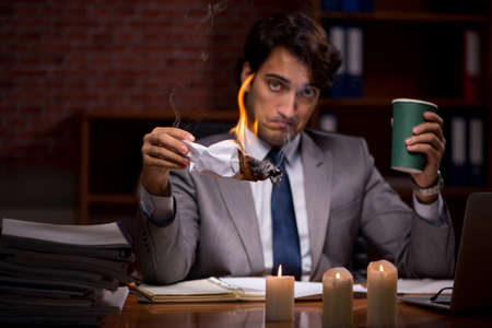 Businessman burning the evidence late in office