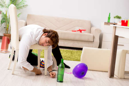 Young man having hangover after party Stockfoto