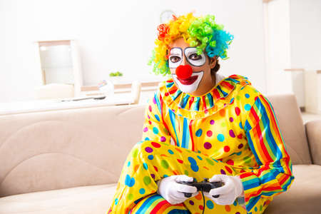 Male clown preparing for perfomance at home Imagens