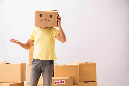 Unhappy man with box instead of his head Foto de archivo