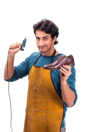 Young handsome shoemaker isolated on white
