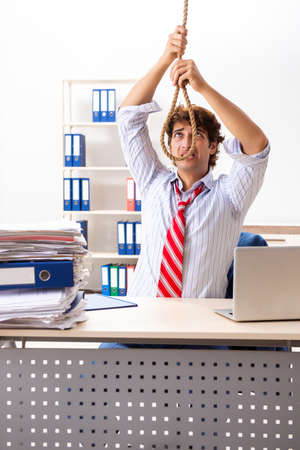Desperate businessman thinking of committing suicide hanging