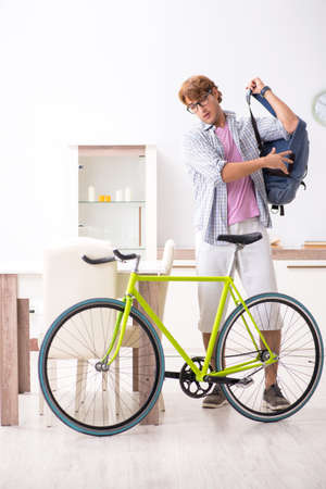 Student commuting to university using cycle Stock fotó