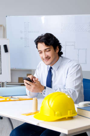 Young handsome architect working on the project