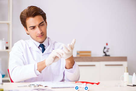 Young expert criminologist working in the lab Stock Photo