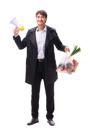 Young handsome man with vegatables in shopping concept