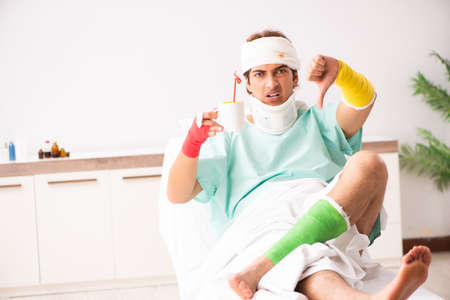Young injured man staying in the hospital Stock Photo