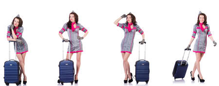 Beautiful stewardess with suitcase isolated on white