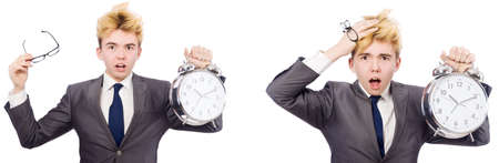 Young boy with alarm-clock in time management concept Banco de Imagens