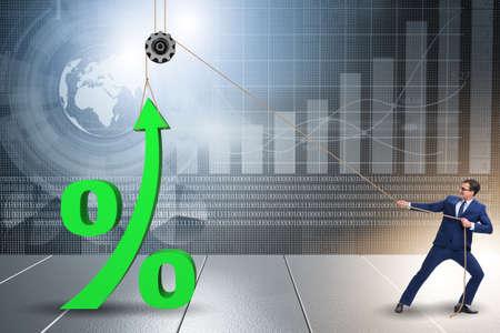 Businessman increasing interest rate in market Stockfoto