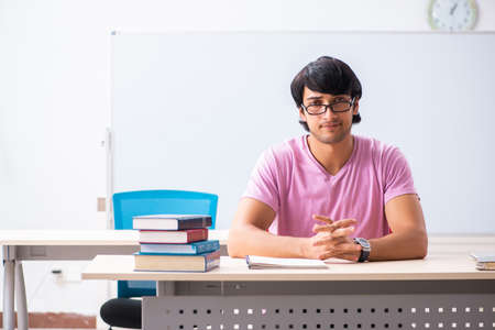 Young male student sitting in the class