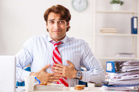 Man having meal at work during break Stock Photo