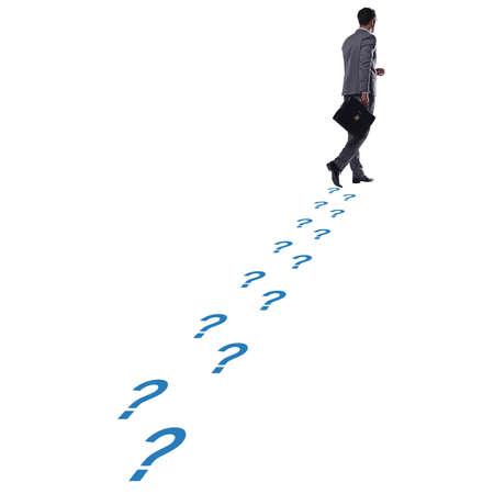 Businessman walking away on question footpath