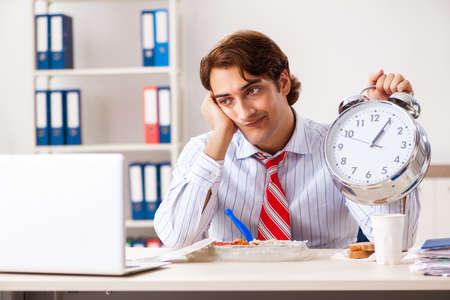 Man having meal at work during break Фото со стока