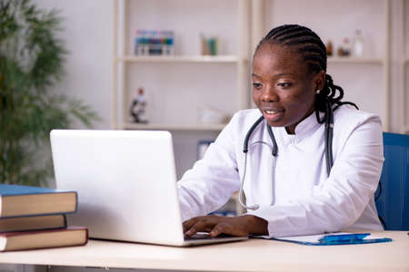 Black female doctor working at clinic