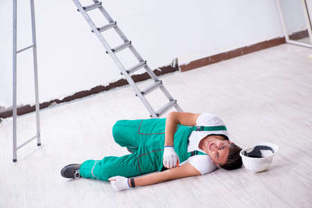 Young worker falling from the ladder Stockfoto