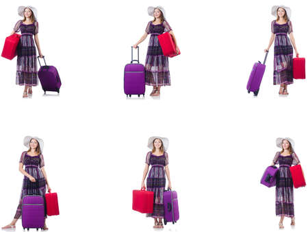 Young woman with suitcases isolated on white Фото со стока