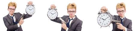 Young boy with alarm-clock and handgun 写真素材