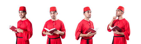 Young Turk with book isolated on white background Stock Photo