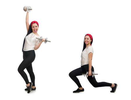 Young woman exercising with dumbbells Stockfoto