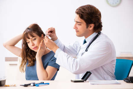 Patient with hearing problem visiting doctor otorhinolaryngologi Stock Photo