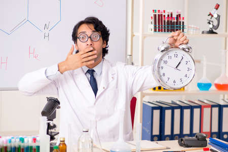 Young funny chemist in front of white board Stock Photo