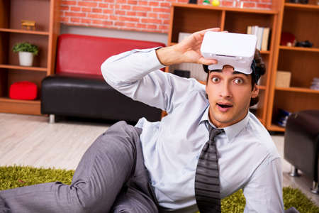 Young employee with virtual glasses during break in the office Stock fotó