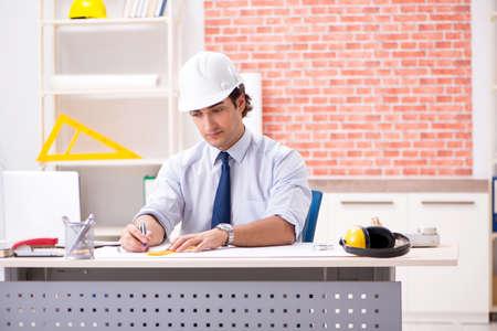 Construction supervisor working on blueprints