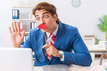 Funny bisinessman with fake lips in the office Stock fotó