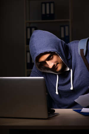 Thief trying to steal personal data in identity theft concept Stock Photo - 115790318