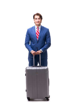 Young handsome businessman with suitcase isolated on white