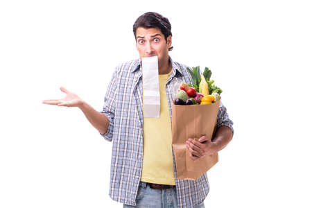 Young man with his grocery shopping on white Stock Photo