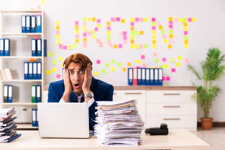 Young employee suffering from excessive work Stockfoto