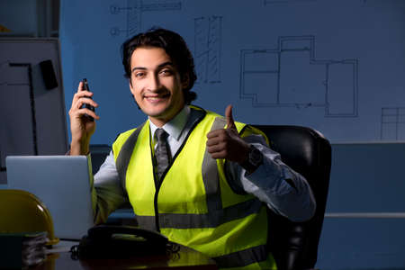 Young construction architect working on project at night Standard-Bild - 116150610
