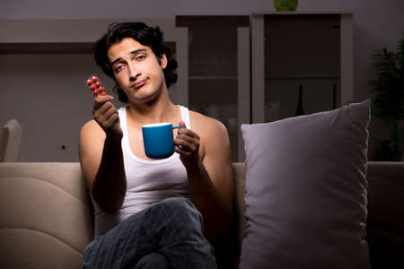 Young man suffering at home night time